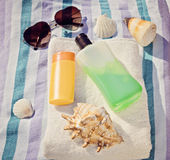 Sun protection creams and glasses on blue background Royalty Free Stock Image