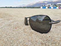 Sun protection glasses in the sand Stock Photography