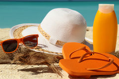 Sun protection items and flip-flops Stock Images
