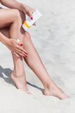 Sun protection for the legs Royalty Free Stock Images
