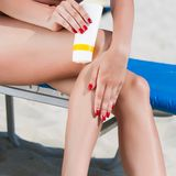 Sun protection for the legs Royalty Free Stock Photography