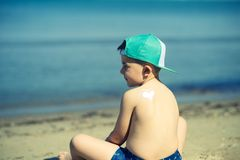Sun protection- little boy with suncream at beach. Sun protection- little boy with suncream at sandy beach in Albania, Durres Stock Images