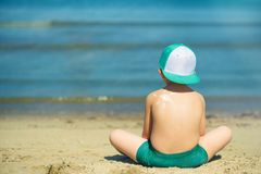 Sun protection- little boy with suncream at beach. Sun protection- little boy with suncream at sandy beach in Albania, Durres Stock Image