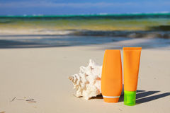 Sun protection tubes and seashell Royalty Free Stock Photography
