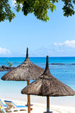 Sun-protection umbrellas, beach, sea. Mauritius Stock Photography