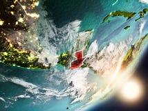 Sun que aumenta acima da Guatemala do espaço Fotografia de Stock Royalty Free