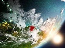 Sun que aumenta acima da Guiana Francesa do espaço Fotos de Stock Royalty Free