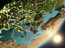 Sun que aumenta acima de Albânia do espaço Fotografia de Stock Royalty Free