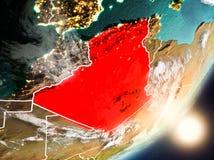 Sun que aumenta acima de Argélia do espaço Foto de Stock