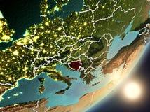 Sun que aumenta acima de Bósnia e de Herzegovina do espaço Foto de Stock Royalty Free