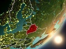 Sun que aumenta acima de Bielorrússia do espaço Fotografia de Stock Royalty Free