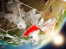 Sun que aumenta acima de Burkina Faso do espaço Imagem de Stock Royalty Free