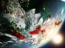 Sun que aumenta acima de Indonésia do espaço Fotos de Stock