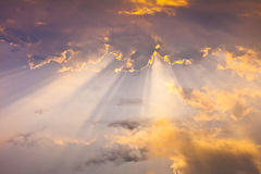 Sun radiation in clouds. In morning stock photo