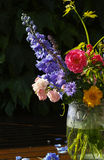 Sun after rain - colorful flowers bouquet in the garden Stock Photos