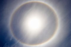 Sun rainbow. Crystals of ice forming sun rainbow around it Royalty Free Stock Image