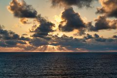 Sun raise out at sea stock image