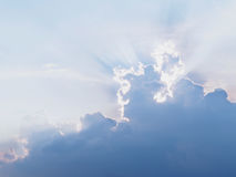 Sun ray behind clouds Royalty Free Stock Photography