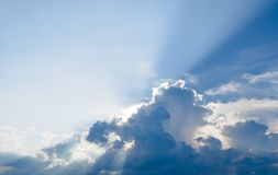 Sun ray, blue sky & clouds. Blue sky & clouds with sun rays, bright & shining, Good for travel or wanderlust background Royalty Free Stock Images