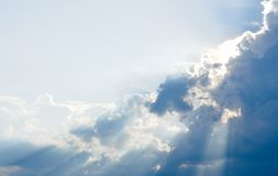 Sun ray, blue sky & clouds. Blue sky & clouds with sun rays, bright & shining, Good for travel or wanderlust background Stock Image