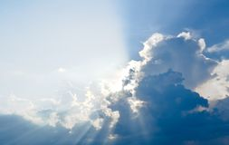 Sun ray, blue sky & clouds. Blue sky & clouds with sun rays, bright & shining, Good for travel or wanderlust background Royalty Free Stock Image