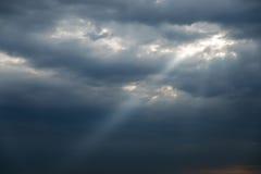 Sun ray in dramatic sky Stock Photos