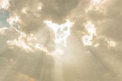 Sun ray light through down from cloud. Stock Image