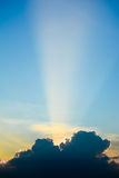 Sun ray shine through dark cloud in the sky. Royalty Free Stock Images