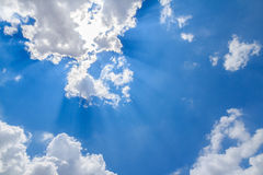 Sun ray shining through the clouds Stock Image