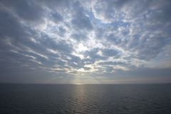 Sun ray in the sky above sea. The Netherlands Royalty Free Stock Photography