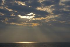 Sun ray in the sky above sea. The Netherlands Stock Image