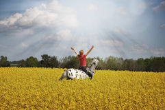 Sun ray. Woman on horse with arms streched towards sun ray Stock Images