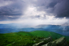 Sun rays. Through the cloudy sky. Carpathian Mountains Stock Photos