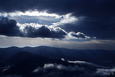 Sun rays. Through the clouds in Baiului mountains Royalty Free Stock Photos