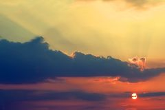 Sun Rays. A colorful sunset with rays beaming brightly up Royalty Free Stock Photography