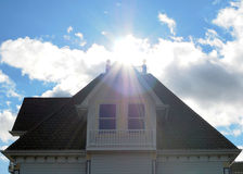 Sun rays above a building roof Royalty Free Stock Photos