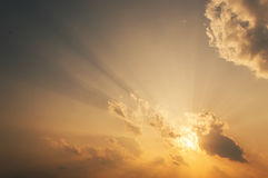 Sun rays above the horizon. The sun rays illuminate the sky above the horizon Stock Photo