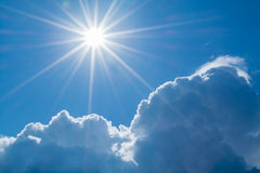 Sun rays against a blue sky in the clouds. Royalty Free Stock Photography