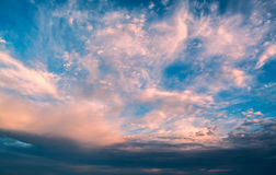Sun rays against a blue sky in the clouds. Stock Image