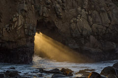 Sun Rays Through the Arch, Pfeiffer Beach. Pfeiffer Beach, Big Sur,  Monterey County, California Royalty Free Stock Photo