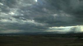 Sun rays beam through cloudy sky. Video of sun rays beam through cloudy sky stock video footage