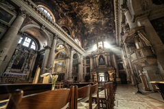 Sun Rays Beaming Through The Old Glass Window of Church. Italy Stock Photo