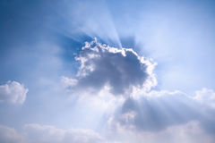 Sun rays behind the cloud Royalty Free Stock Photo