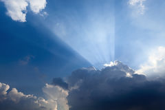 Sun rays behind the cloud. Sun rays and clouds,beautiful blue sky Stock Photography