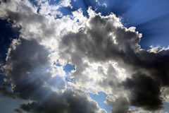 Sun rays behind clouds Royalty Free Stock Image