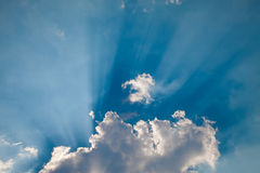 Sun Rays, Blue Fluffy Clouds Royalty Free Stock Photos