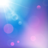 Sun rays on blue and purple colored background Stock Photos