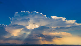 Sun rays on blue sky Stock Photos