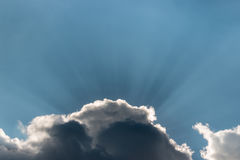 Sun rays breaking through clouds Stock Image