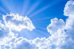 Sun rays breaking through the clouds on sky Royalty Free Stock Photo